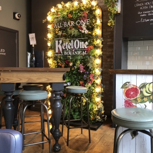 Ketal One Bar Corporate Flower wall and lights