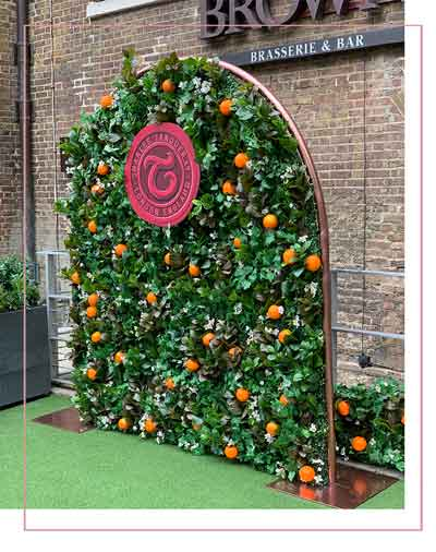 corporate gin product launch flower wall